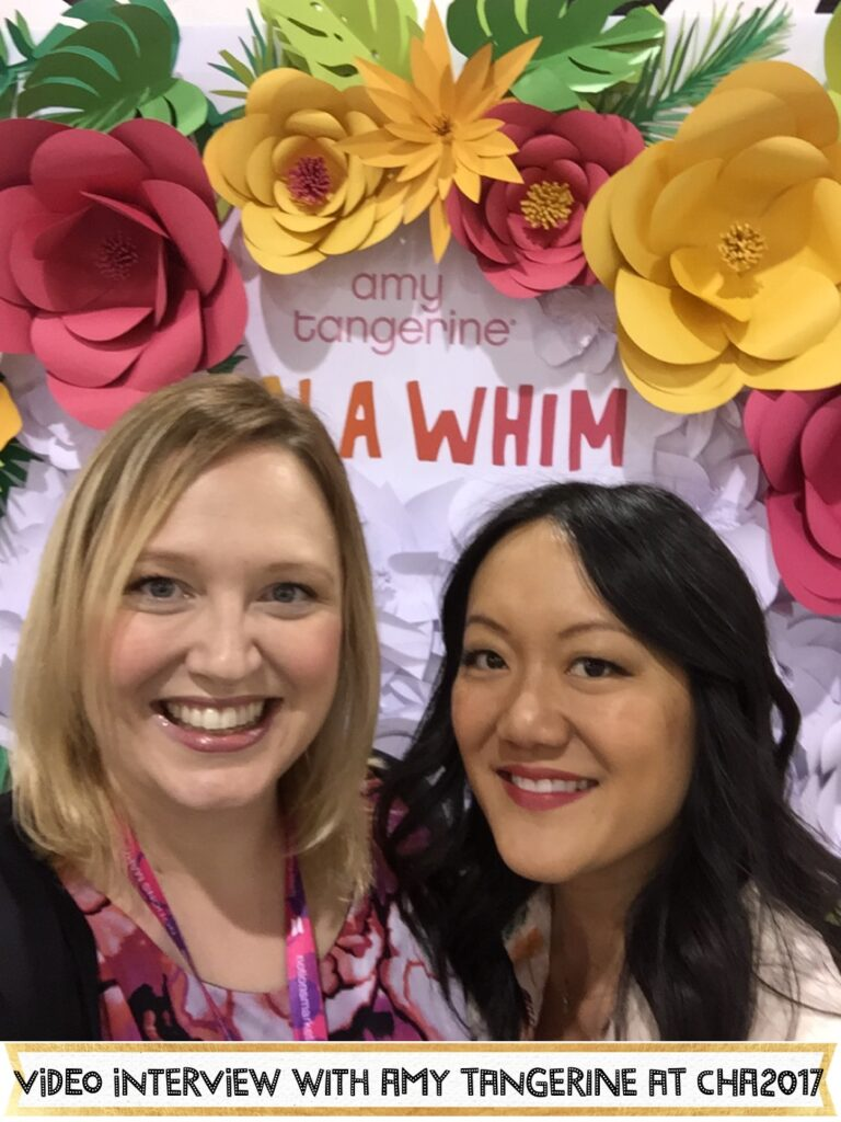 Amy Tangerine gives us a tour of her booth at CHA2017, talks about her new line, On a Whim, and tells us a bit about her book Craft A Life you Love. #CHA2017 #amytangerine #onawhim #scrapbooking #craftalifeyoulove