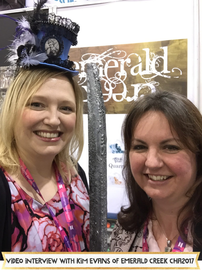 Kim Evans from Emerald Creek Craft Supplies shares her collection of rubber stamps, embossing powders and custom charms (including stones!) at her booth at CHA2017 Creativation. She shares paper and embellishment collections from Wild Whisper for their first time at CHA. #scrapbooking #embossingpowder #stamping #rubberstamps #emeraldcreek #wildwhisper #cha2017 #creativation #aliceboll #scrapbookwonderland